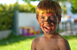 Happy boy with painted face. Portrait of happy young boy with painted face outdoors Royalty Free Stock Photos