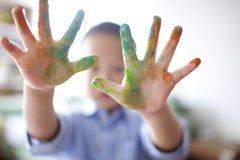 Happy boy with painted hands Royalty Free Stock Photo