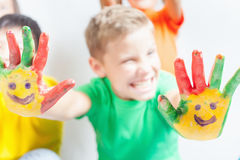 Happy boy with painted hands. International Children's Day. Happy boy with painted hands on a white background. Smile. International Children's Day. Painting royalty free stock photography