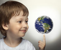 Happy boy with panet Earth in hand Stock Photos