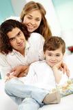 Happy boy and parents Stock Photos