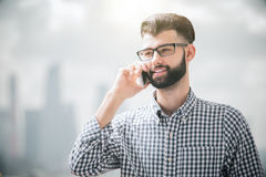Happy boy on phone Stock Images
