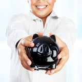 Happy boy with piggy bank Royalty Free Stock Photography
