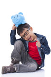 Happy boy with piggy bank Stock Photos