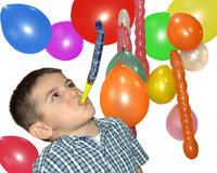 Happy boy play with air whistle Stock Image