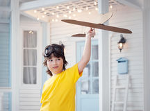 Happy boy play with airplane in hand, child dreams about traveli Royalty Free Stock Images