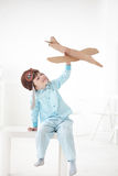 Boy play in airplane Stock Photography