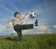 Happy boy play in soccer Stock Photo