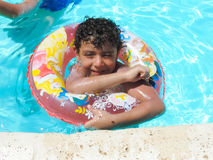 Happy Boy play at swimming Pool. Egypt, Nov. 23 2014 : Happy people and girls in bikini enjoying bath time in pool, Sharm el-Sheikh Royalty Free Stock Images