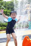 Happy boy play water in waterpark Stock Photos