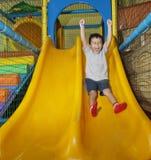 Happy boy on playground. Happy little boy sliding on playground Stock Photo