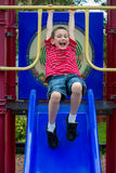 Happy boy in playground Stock Images