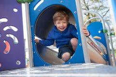 Happy Boy on Playground Equipment Stock Images