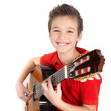 Happy boy is playing on acoustic guitar. Isolated on white background Royalty Free Stock Image