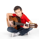 Happy  boy is playing on acoustic guitar Royalty Free Stock Photo