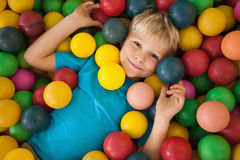 Happy boy playing in ball pool Stock Image