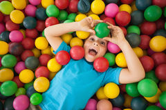 Happy boy playing in ball pool Stock Images