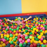 Happy boy playing in ball pool Royalty Free Stock Photo