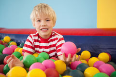 Happy boy playing in ball pool Royalty Free Stock Images