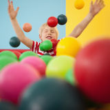 Happy boy playing in ball pool Royalty Free Stock Photos