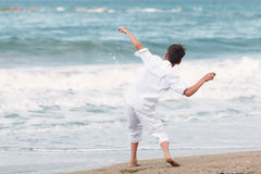 Happy boy playing on beach, Spain Stock Images