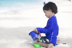 Happy Boy Playing at the beach Royalty Free Stock Photos