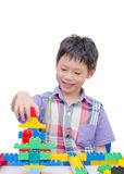 Happy boy playing with building blocks Royalty Free Stock Images