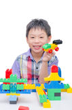 Happy boy playing with building blocks Royalty Free Stock Photos