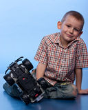 Happy boy playing with car Royalty Free Stock Photography
