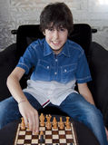 Happy Boy is Playing Chess Royalty Free Stock Photo