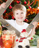 Happy boy playing in Christmas Stock Image