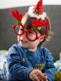 Happy boy playing with Christmas decorations. Happy young boy smiling, playing and having fun with Christmas decorations Royalty Free Stock Photos