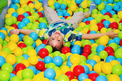 Happy boy playing in the dry pool Royalty Free Stock Image