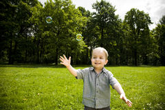 Happy boy playing in field Stock Image