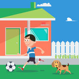 Happy Boy Playing Football with Dog. Stock Images