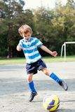 Happy boy playing football. Outdoor Royalty Free Stock Images