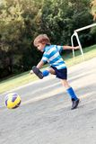 Happy boy playing football. Outdoor Royalty Free Stock Photos
