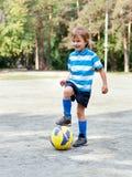 Happy boy playing football Royalty Free Stock Photo