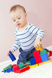 Happy boy playing frame construction. Royalty Free Stock Photos