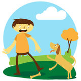Happy boy playing with his dog Royalty Free Stock Photography
