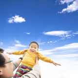 Happy boy playing with his father Royalty Free Stock Photo