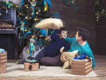 Happy boy playing with his father on Christmas Stock Photos