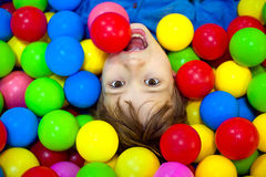 Free Happy Boy Playing In Colorful Balls. Happy Child Playing At Colorful Plastic Balls Playground High View Stock Image - 88000981