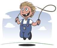 Happy boy playing jump rope Stock Image