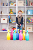 Happy boy playing kids bowling game. Boy playing ten pin bowling in play room Royalty Free Stock Photo