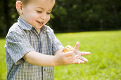 Happy boy playing outdoors Stock Images