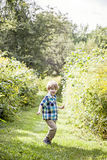 Happy boy playing outside Royalty Free Stock Images