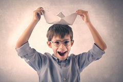 Happy boy playing with a paper boat Royalty Free Stock Image
