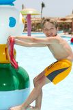 Happy boy playing in pool Stock Image