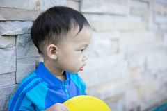 A happy boy is playing at the pool. A happy asian boy is playing at the pool Stock Photos